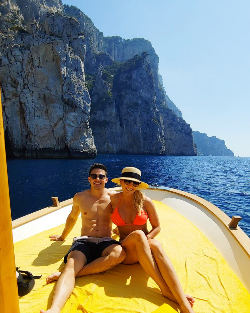 couple on a private boat in capri