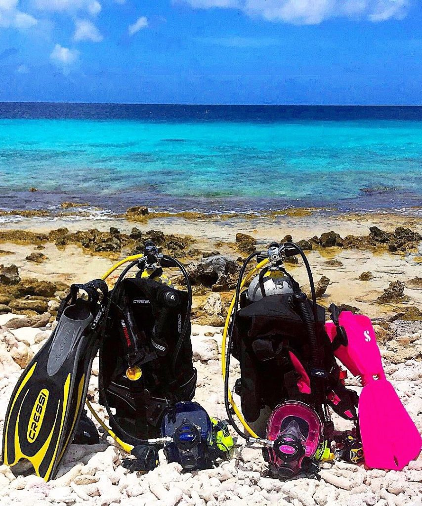 scuba diving equipment on a beach in Bonaire